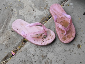 muddy flip flops